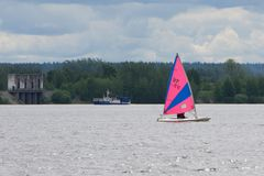 Yachting race. Sailing regatta. Yachts with pink spinnaker in the sea on sunny windy day . royalty free stock images