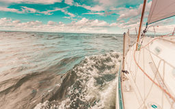 Yachting on sail boat bow stern shot splashing water Royalty Free Stock Photos