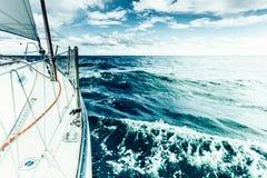 Yachting on sail boat bow stern shot splashing water Stock Photography
