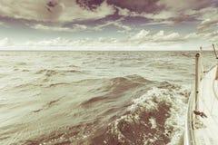 Yachting on sail boat bow stern shot splashing water Stock Photos