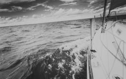 Yachting on sail boat bow stern shot splashing water stock images