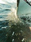 Yachting on sail boat bow stern shot splashing water royalty free stock photo