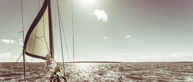 Yachting on sail boat during sunny weather Royalty Free Stock Photo