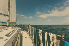 Yachting on sail boat during sunny weather Stock Photography