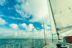 Yachting on sail boat during sunny weather royalty free stock photos