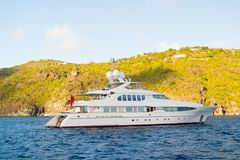 Yachting and sailing adventure in gustavia, st.barts. Yacht at sea coast on sunny blue sky. Luxury travel and voyage on boat. Summ Royalty Free Stock Photography