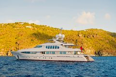 Yachting and sailing adventure in gustavia, st.barts. Yacht at sea coast on sunny blue sky. Luxury travel and voyage on. Boat. Summer vacation on tropical stock photography