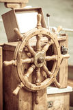 Yachting. Ship wooden steering wheel. Sailboat detail. Stock Photo