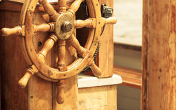 Yachting. Ship wooden steering wheel. Sailboat detail. Royalty Free Stock Photo