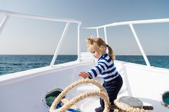 Yachting sport. Child cute sailor help with ropes yacht bow. Adventure boy sailor travelling sea. Baby boy enjoy Royalty Free Stock Photo