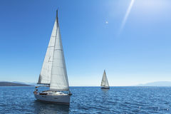 Yachting. Tourism. Luxury Lifestyle. Ship yachts with white sails in the open sea. Stock Images