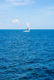Yachting. Tourism. Luxury Lifestyle. Ship yachts with white sails in the open sea. Royalty Free Stock Image