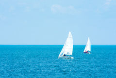 Yachting. Tourism. Luxury Lifestyle. Ship yachts with white sails in the open sea. Stock Photography