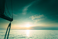 Yachting yacht sailboat in baltic sea at sunset sunrise. Royalty Free Stock Photo