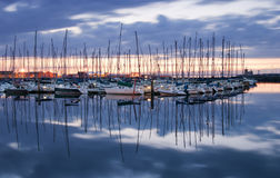 Yachts. Reflections of Yachts in still water at port Royalty Free Stock Image