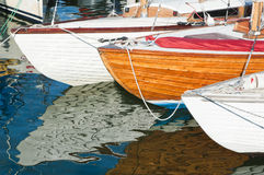 Yachts. And their reflections in water Stock Photo