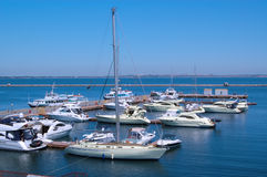 Yachts. Few yachts standing still on the pier Stock Images