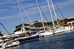 Yachts. Beautiful   white and black yachts moored to wharf at the harbor Royalty Free Stock Photo