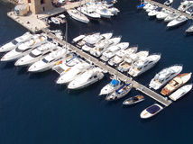 Yachts. A collection of luxury yachts in Monaco Harbour royalty free stock photography