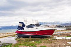 The yachts are aground in shallow sea water. Boat run aground in waterless pier or harbor. Stock Images