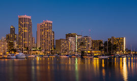 Yachts in Ala Moana harbor in Waikiki at night Royalty Free Stock Photo