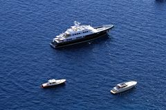 Yachts anchored. Luxury yachts and cruise anchored Stock Images