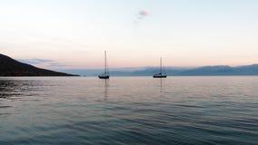 Yachts Anchored in Bay at Dawn Stock Photos