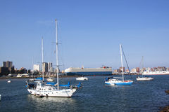 Yachts Anchored in City and Harbour Landscape Royalty Free Stock Photo