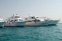 Yachts. Anchored on clean blue water, Egypt Stock Photos