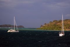 Yachts anchored in Fiji. Catamaran and monohull yachts anchored in Fiji Stock Photos