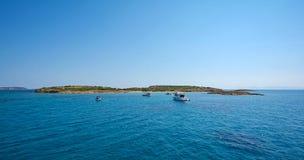 Yachts anchored at a Greek islet. Stock Photos