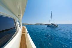 Yachts anchored at a Greek islet. Stock Photo