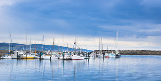 Yachts anchored in a marina with a stormy sky Royalty Free Stock Image
