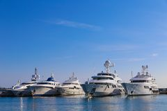 Yachts anchored in Port Pierre Canto in Cannes. CANNES, FRANCE - APRIL 12, 2015: Yachts anchored in Port Pierre Canto at the Boulevard de la Croisette in Cannes Stock Photos