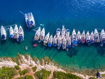 Yachts ancored in a bay with clear blue waters aerial view. Cephalonia is a typical Mediterranean Island well known tourist destination for the summer in Royalty Free Stock Images
