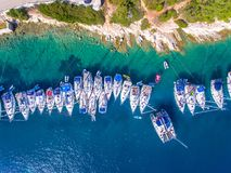Yachts ancored in a bay with clear blue waters aerial view. Cephalonia is one of the most known islands of Greece in the Mediterranean sea with it`s typical Royalty Free Stock Images
