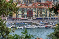 Yachts and architecture in the Port de Nice in French Riviera, F. NICE, FRANCE - MAY 14, 2013: Yachts and architecture in the Port de Nice in French Riviera stock image