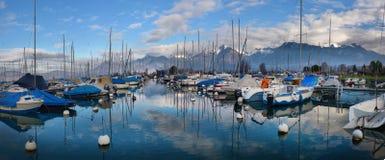 Yachts on autumn parking lot on Lake Geneva, SWISS royalty free stock photo
