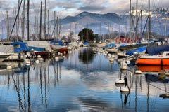 Yachts on autumn parking lot on Lake Geneva, SWISS royalty free stock photos