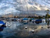 Yachts on autumn parking lot on Lake Geneva Royalty Free Stock Images