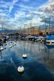 Yachts on autumn parking lot on Lake Geneva Royalty Free Stock Photography