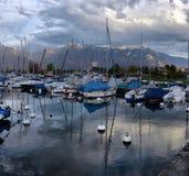 Yachts on autumn parking lot on Lake Geneva Royalty Free Stock Photos