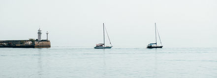 Yachts on the background of the misty horizon Royalty Free Stock Image