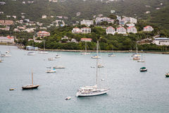 Yachts in Bay Beneath Tropical Resorts Royalty Free Stock Photography