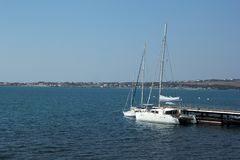 Yachts in the Bay. With their sails stand at the pier Stock Photo