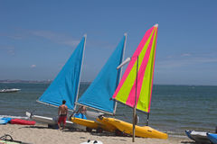 Yachts on beach. Three yachts on beach with sea behind Royalty Free Stock Photography
