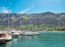Yachts at the berth. With mountains on the background Stock Photos