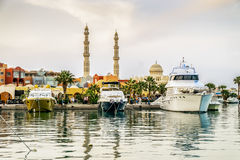 Yachts berthed at the port of Hurghada, Hurghada Marina at dusk. Yachts berthed at the port of Hurghada, Hurghada Marina at sunset against the mosque, April 15 Royalty Free Stock Photo