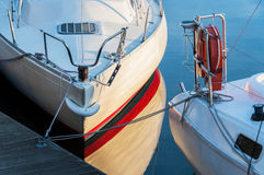 Yachts berthed in yacht harbor. Stock Image