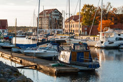 Yachts berthed in yacht harbor. Royalty Free Stock Image